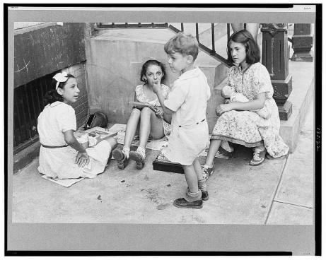 New York, New York. 61st Street between 1st and 3rd Avenues. Children playing in the street.  Library of Congress, Prints & Photographs Division, FSA/OWI Collection, LC-USF3301-006722-M1 (b&w film dup. neg.)
