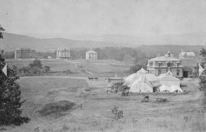 Massachusetts Agricultural College in the late nineteenth century, looking west from the eastern ridge of campus, home of Durfee Conservatory, toward Chestnut Ridge, home of the College's original main buildings.